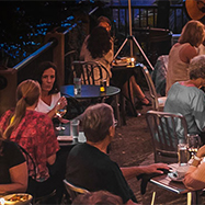 People eating outdoors at Cafemantic in Willimantic