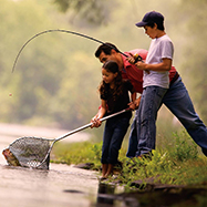 Father fishing with Son and Daughter