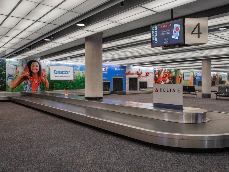 The Office of Tourism has an ongoing relationship with Bradley Airport, allowing tourism messaging to cover every possible inch of wall space in the baggage claim area. This permanent installation features 13 different experiences covering all four seasons.